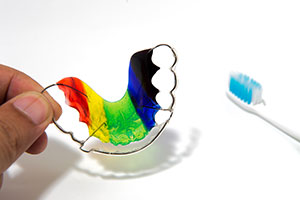 A colorful retainer with a toothbrush