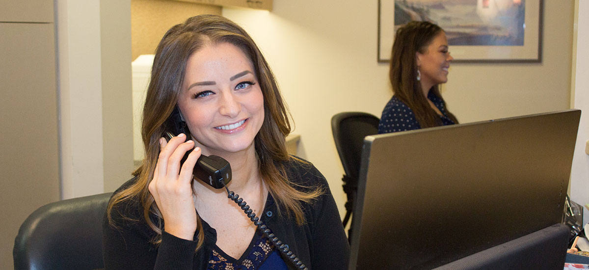 Pacific Orthodontics friendly staff are taking phone calls.
