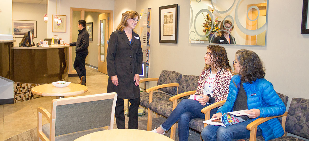 Dr. Doppel visits with new patients in the waiting area